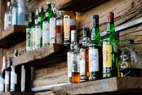 Alcoholic Drinks on the Shelves of a Bar