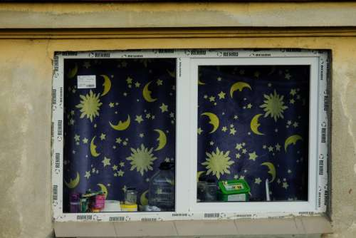Closeup on a Window with Blue Night Curtains