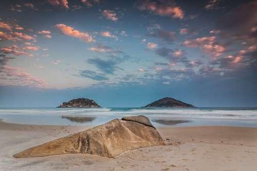 A Stoney Mound On The Beach Photo