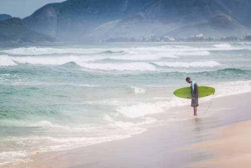 A Surfer Contemplates The Water's Edge Photo