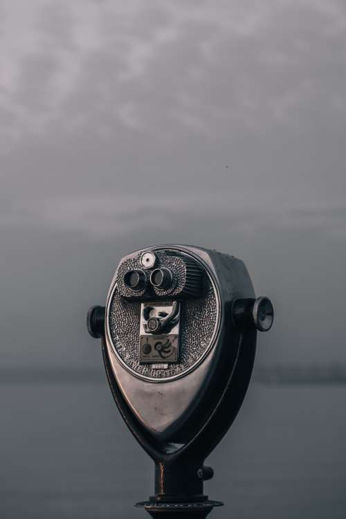 A Tower Viewer Overlooks A Watery Grey Shoreline Photo
