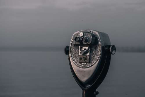 A Tower Viewer Still Glittering in Water Droplets Photo