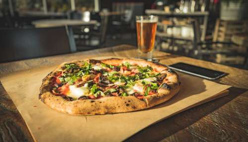 Dinner For One Of Wood Fired Pizza Paired With Cold Beer Photo