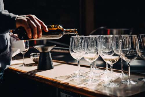 Filling Wine Glasses On Counter Photo