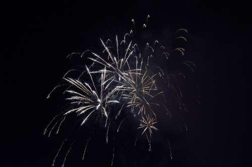 Fireworks Bursting Through The Night Sky Photo