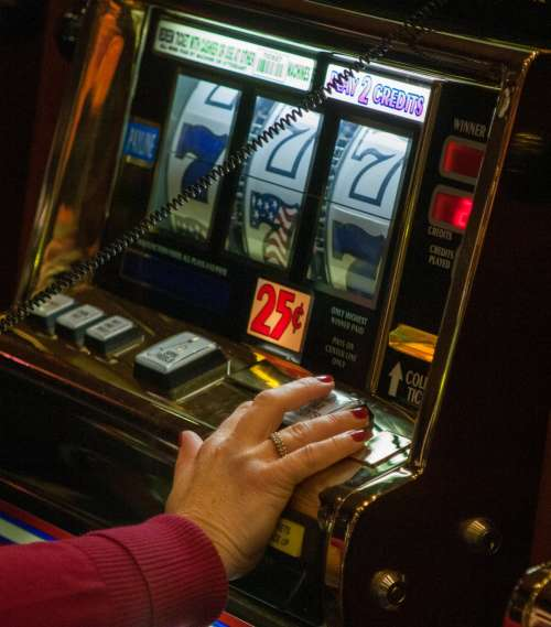 Hand On Slot Machine Photo