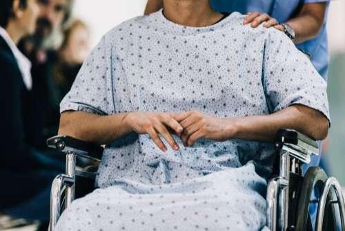 Nervous Patient In Wheelchair Photo