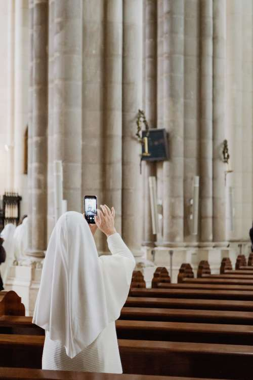 Nun Snaps A Photo In An Old Church Photo