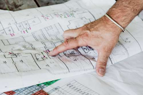 Pointing To Blueprints Photo