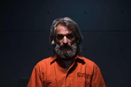 Prisoner Sat In A Dark Room Photo