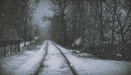 Puffy Snowflakes Cover Retired Railroad Tracks Along Path Photo