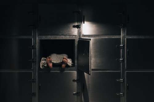 Uncovered Body In A Morgue Freezer Photo