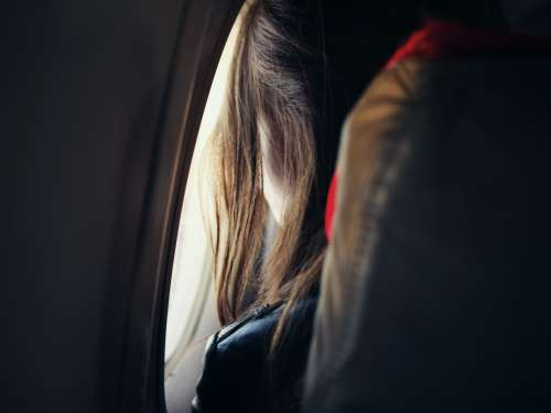 girl passenger woman airplane window
