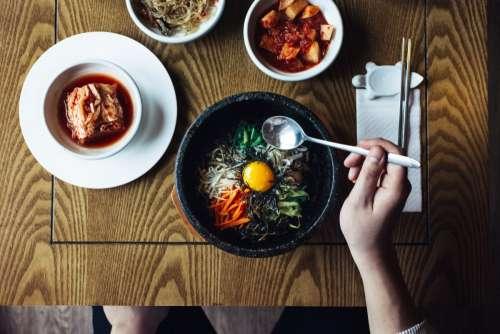 Eating Korean bibimbap and kimchi