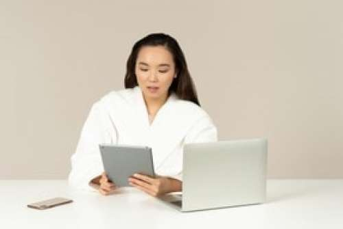 Young Asian Woman Holding Tablet And Doing Online Shopping