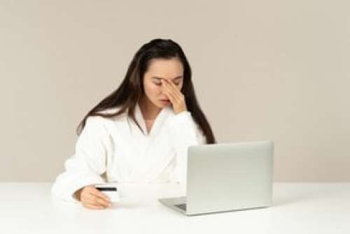 Young Asian Woman Looking Upset While Doing Online Shopping