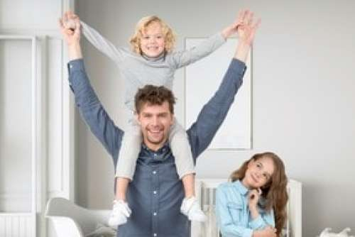 Kid Sitting Up On Father's Neck And Kid Girl Standing Naer