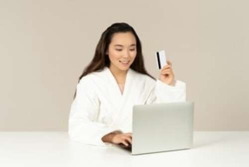 Young Asian Woman Doing Online Shopping