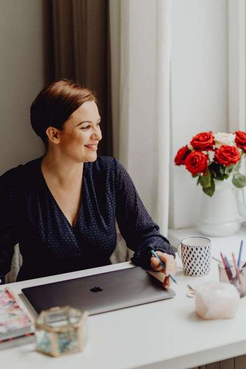 Happy casual beautiful woman working on a laptop