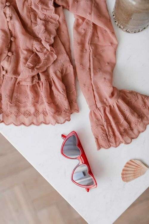 Blouse in pale pink colour made of thin chiffon with frills