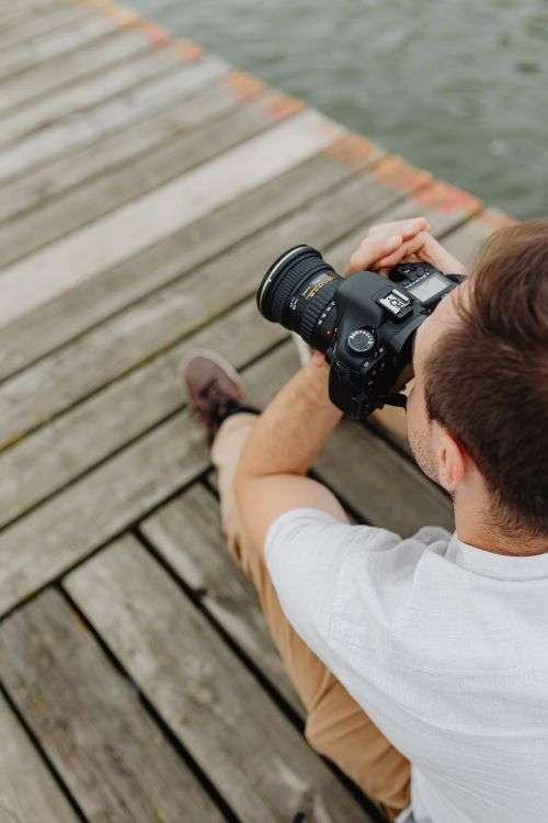 Photographer holding a DSLR camera