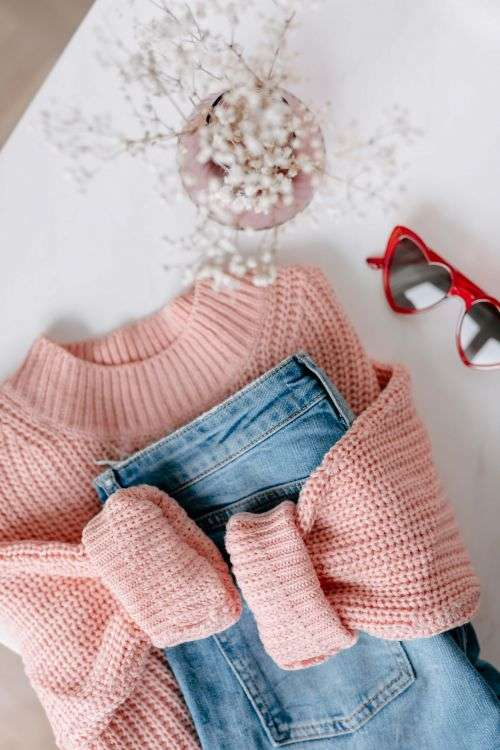 Flat lay collage - women's modern casual outfit, pink sweater, jeans, sunglasses