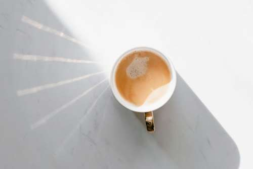 Cup of coffee on white marble