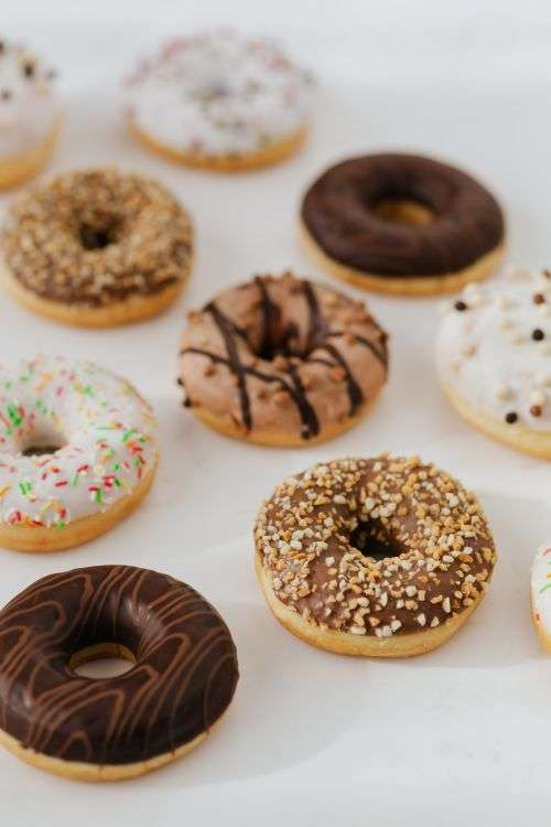 Various donuts on white marble