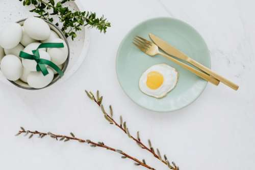 Easter flat lay with eggs on a white marble