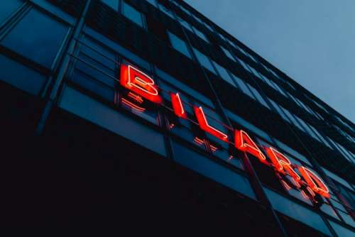 Neon sign Bilard on the building