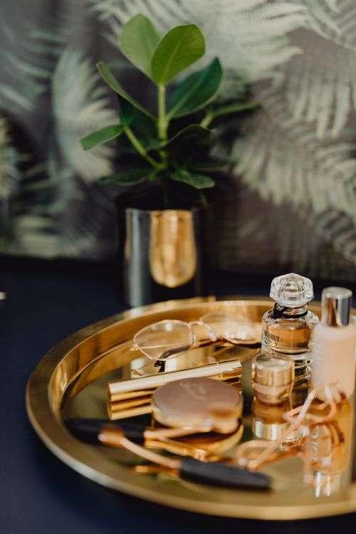 Makeup essentials on a golden tray
