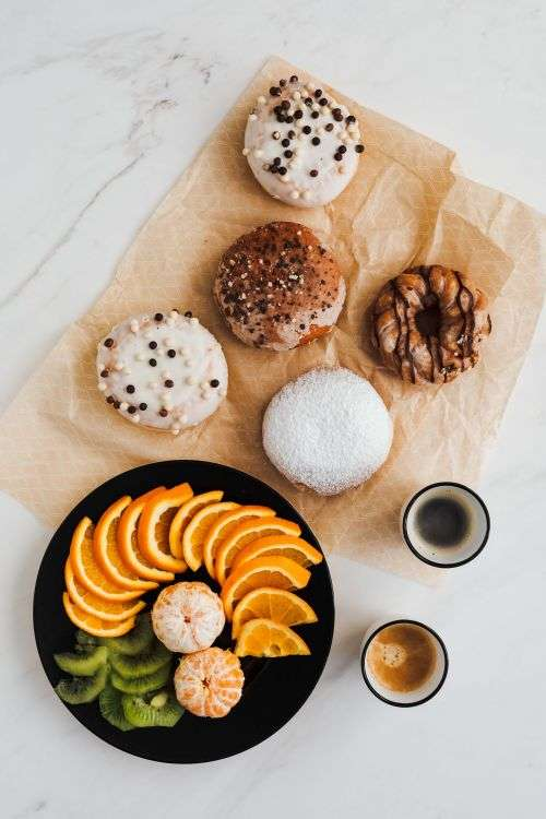 Donuts & Pączki with fruit and coffee