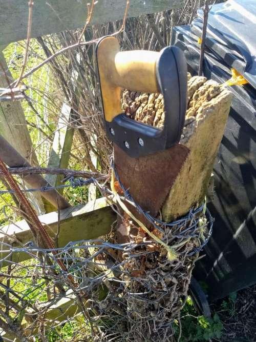 old saw rusty saw fencepost