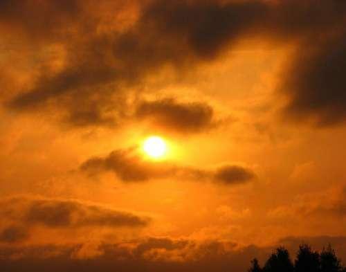 sunset clouds sky gold orange