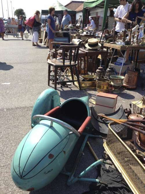antiques fair sidecar chairs turquoise hat