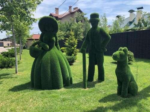 sculptures grass green people dog