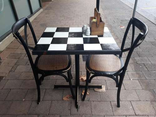Hotel table checkered chairs outdoor cafe