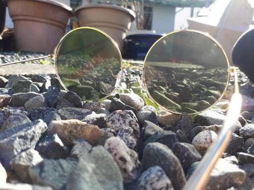 sunglasses sun rocks reflection