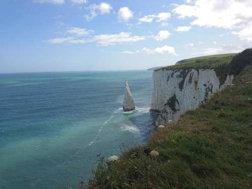sea rocks beach cliffs nature