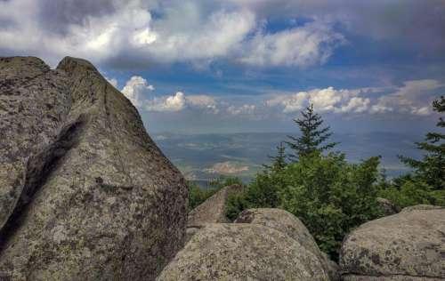 stones mountain nature clouds landscape