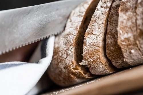 Slicing Bread Knife Close Up Free Photo