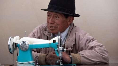 Ecuador Guamote Market Sew Hand Labor Portrait