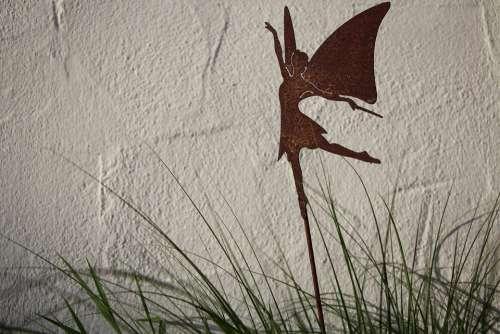 Fee Grass Figure Rust