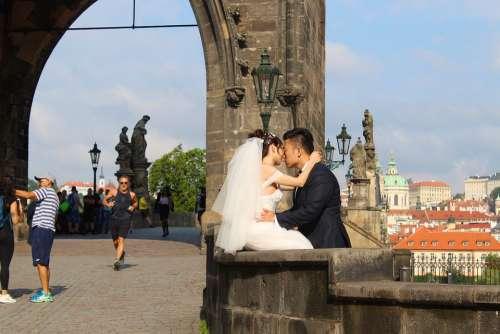 Prague Charles Bridge Bride And Groom Kiss
