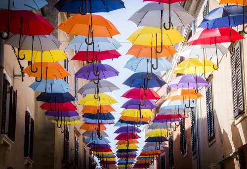 Umbrella Hanging Street Building Colorful Sky