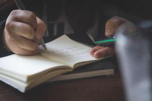 notebook pen hand writing study