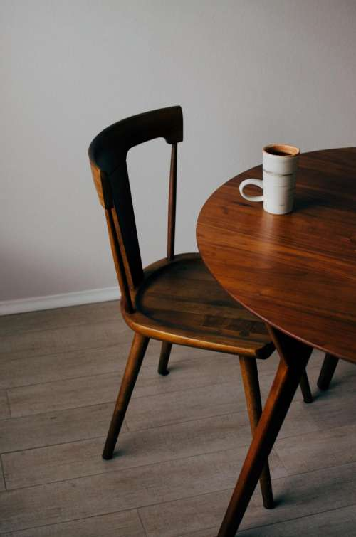 wooden chair table mug cup