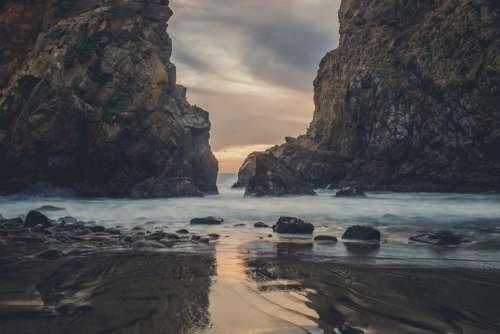 beach sand ocean sea rocks