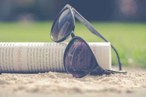 sunglasses magazine beach travel vacation