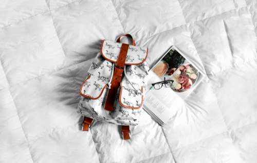 white bed bag backpack book